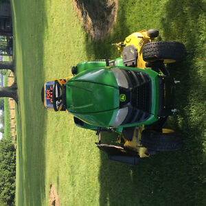 Excellent lawn mower with 2 year warranty left