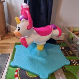 Musical unicorn ride-on