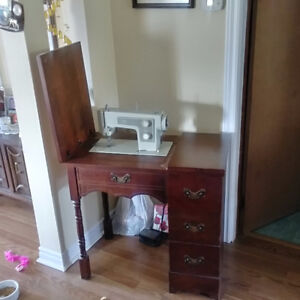 Vintage sewing machine with wood stand