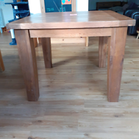 Oak table and 2 chairs.