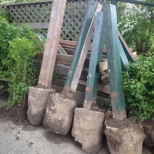 FREE - Fence posts, concrete footings, wooden railing