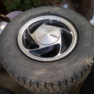 Enkei mags with winter tires, 14 inch,