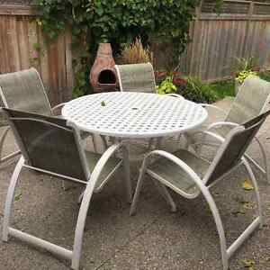 Patio Table with 6 chairs, side table and ottoman