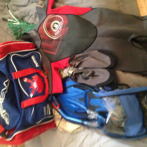 snorkeling gear with wetsuit and bag