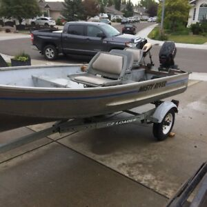 14' Misty river with 15hp Mercury outboard