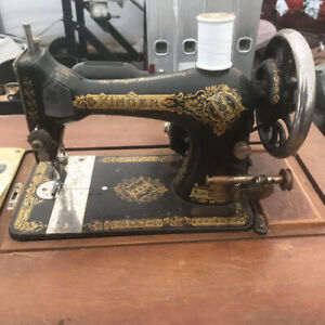 Older metal singer sewing machine with cabinet