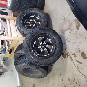 35 inch Toyo Tires Open Country A/T on 20 inch Fuel rims.