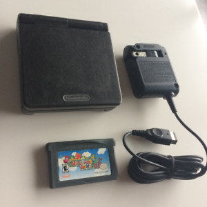 Black Gameboy Advance SP with Super Mario Advance game