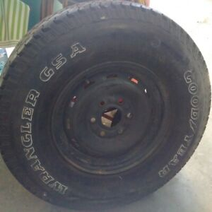 For sale LT265/75R16 Goodyear Wrangler on a 6 bolt black GMC Rim