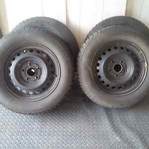 WINTER TIRES W RIMS FOR QUICK SALE