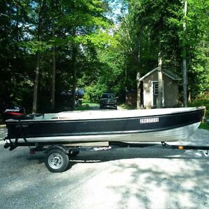14 ft. Starcraft fishing boat, 25 hp Merc and trailer