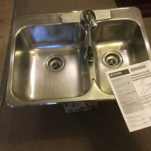 Stainless steel sink and new faucet
