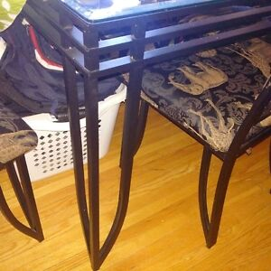 raw iron glass table and 4 chairs $75.00