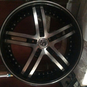 20 inch Polished Aluminum and Black wheels with rivets.