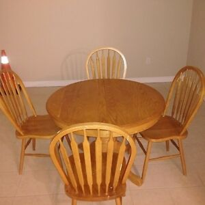 Dining room table with 4 chairs - nice condition, solid wood