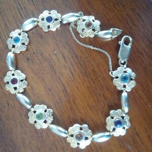Bracelet en or 14 k. avec pierres précieuses