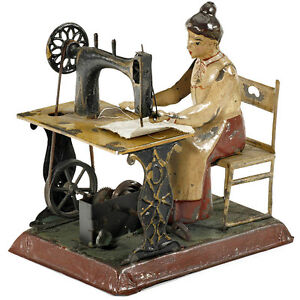 Woman-on-Sewing-Machine-c-1905-Gunthermann-hand-painted-tin-clockwork-working