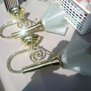 2 brass/frosted glass wall sconce lights.