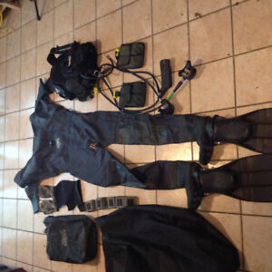 Scuba gear with large dry suit open to reasonable offers.
