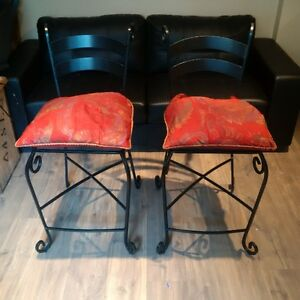 Cast Iron bar stools with cusions.