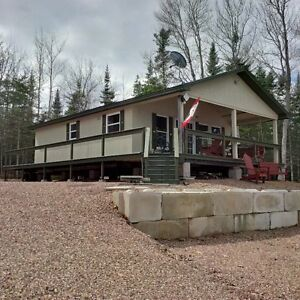 Waterfront cottage for sale in Cumberland Bay on Grand Lake