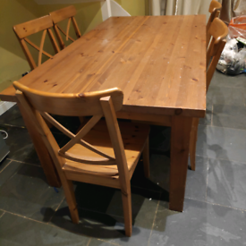 solid wood dining table and 5 chairs