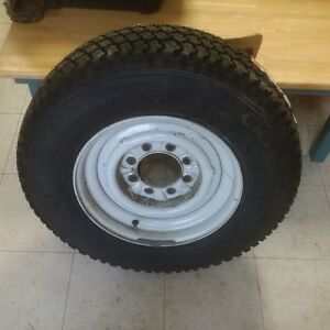 """Brand new 16.5"""" tire and rim"""