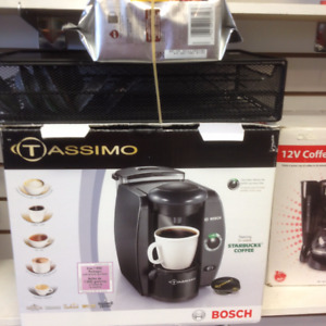 Tassimo coffee machine with disc holder, and pack of coffee