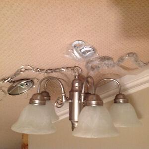 Brushed Nickel 5 light chandelier...never used