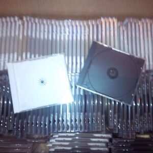 85x CD cases, like new condition, black and white