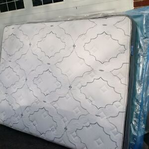Brand new queen box  spring and almost brand new Matress