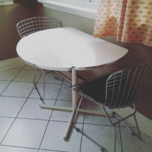 Retro/modern drop-leaf dining table with chrome edging.