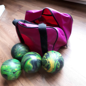 4 bowling  balls and carrying  bag
