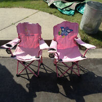 2 pink children's folding chairs one princess other butterfly
