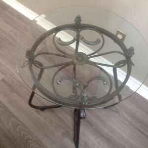 Set of 3 glass/wrought iron tables.