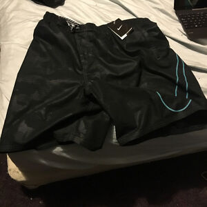 Nike shorts swimming tags attached