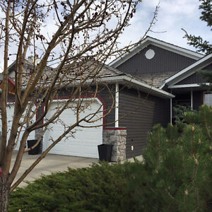 """""""AIRDRIE""""  Woodside Golf Course Executive Walk-out Bungalow"""