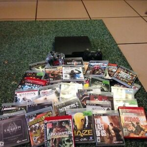 PS3, 2 Controllers and 35 Games