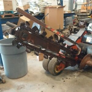 Trencher articulates, very strong, newer honda engine.
