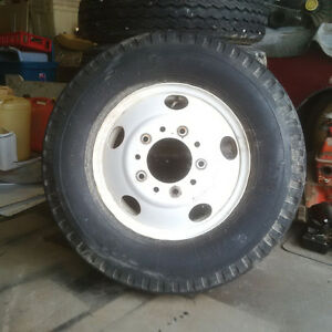 "8.25 x 20"" tires on rims"