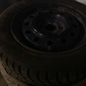 Four winter tires on rim