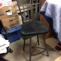 Two Counter height swivel chairs