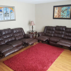 2 Recliner leather couch for 1850$$$ * Only 6months old*
