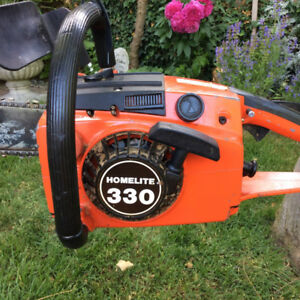 Chainsaw Homelite 330 with heavy duty safety chain brake.