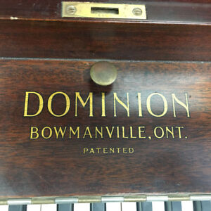DOMINION UPRIGHT PIANO. ONLY $200.