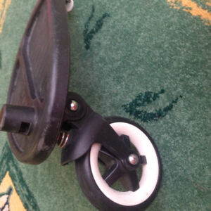 Bugaboo wheeled board with attachments in good condition