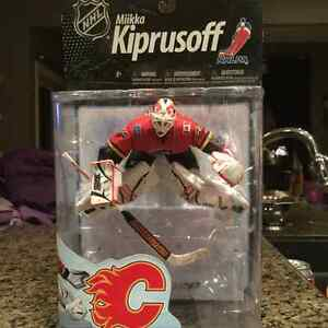 Sealed Calgary Flames and Vancouver Olympics hockey figures