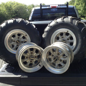 Four Maxxis rims and two Mud Bug tires