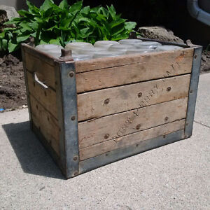 Antique milk bottles and crate