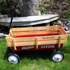 Radio Flyer classic red vintage style metal and wooden wagon.